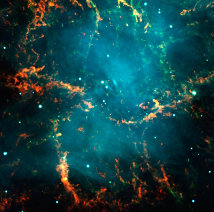 "This image is an enlargement of a three colour composite of the well-known Crab Nebula  (also known as ""Messier 1""), as observed with the FORS2 instrument in imaging mode in the morning of November 10, 1999. It is the remnant of a supernova explosion at a distance of about 6,000 light-years, observed almost 1000 years ago, in the year 1054. It contains a neutron star near its center that spins 30 times per second around its axis. In this picture, the green light is predominantly produced by hydrogen emission from material ejected by the star that exploded. The blue light is predominantly emitted by very high-energy (""relativistic"") electrons that spiral in a large-scale magnetic field (so-called synchrotron emission). It is believed that these electrons are continuously accelerated and ejected by the rapidly spinning neutron star at the centre of the nebula and which is the remnant core of the exploded star."