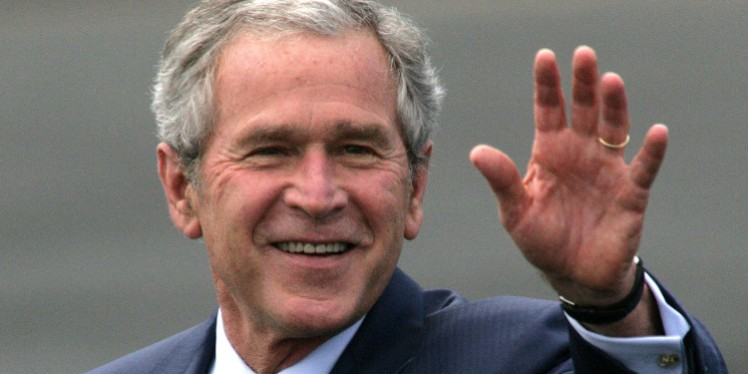 U.S. President George W. Bush waves upon arrival at RAF Aldgerove in Belfast, Northern Ireland, on Monday, June 16, 2008. Gordon Brown, U.K. prime minister    said Britain is pushing the European Union to impose new sanctions against Iran, including freezing the assets of its biggest bank, to pressure the nation to give up its nuclear program at a press conference with Bush in London today. Photographer: Paul McErlane/Bloomberg News