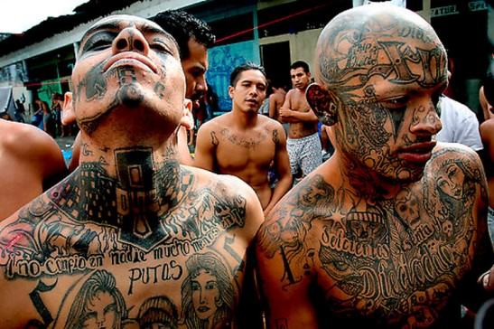 """GUATEMALA GANGS -- Gang members hang out at the courtyard inside El Hoyon prison, in Escuintla, Guatemala. A string of violent and mysterious killings targeting gang members and criminals in Guatemala has prompted rumors of a """"social cleansing,"""" an effort to weed out undesirable members of society. Some blame police, others point a finger at vigilante groups sick of rising crime. Police say rival gangs are responsible."""